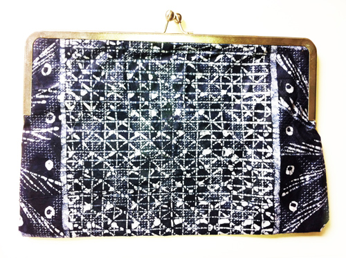 clutch with gold and an abstract black and white pattern