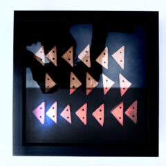 Follow>plan>journey Abstract textile print with pink triangle on blue background