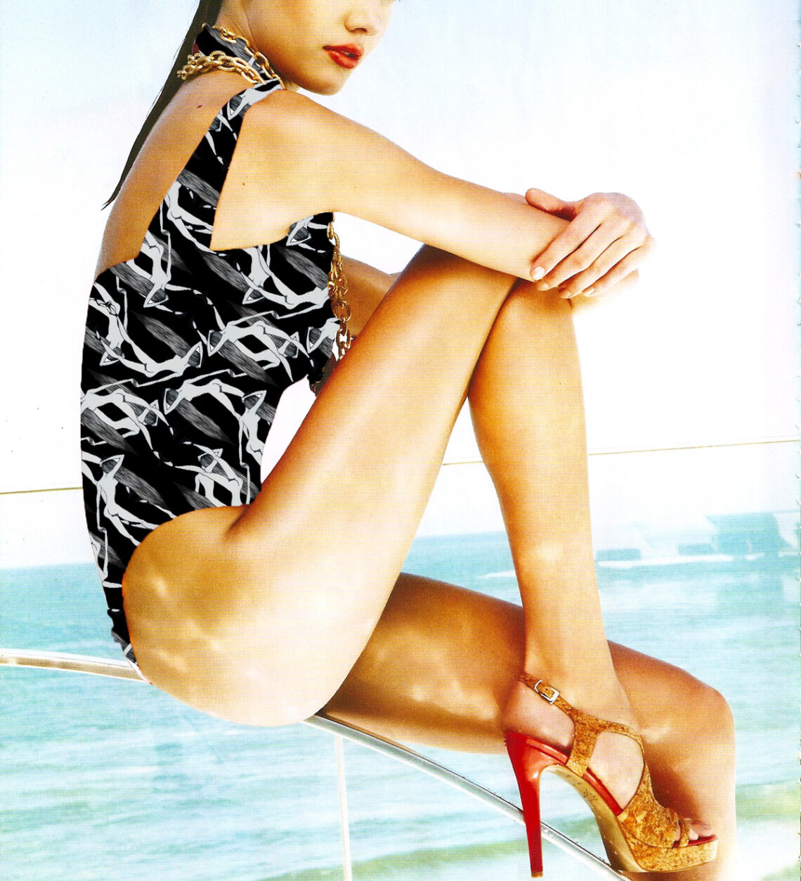 Fashion phtogography of giurl at the beach wearing an abstract printed swimming costume