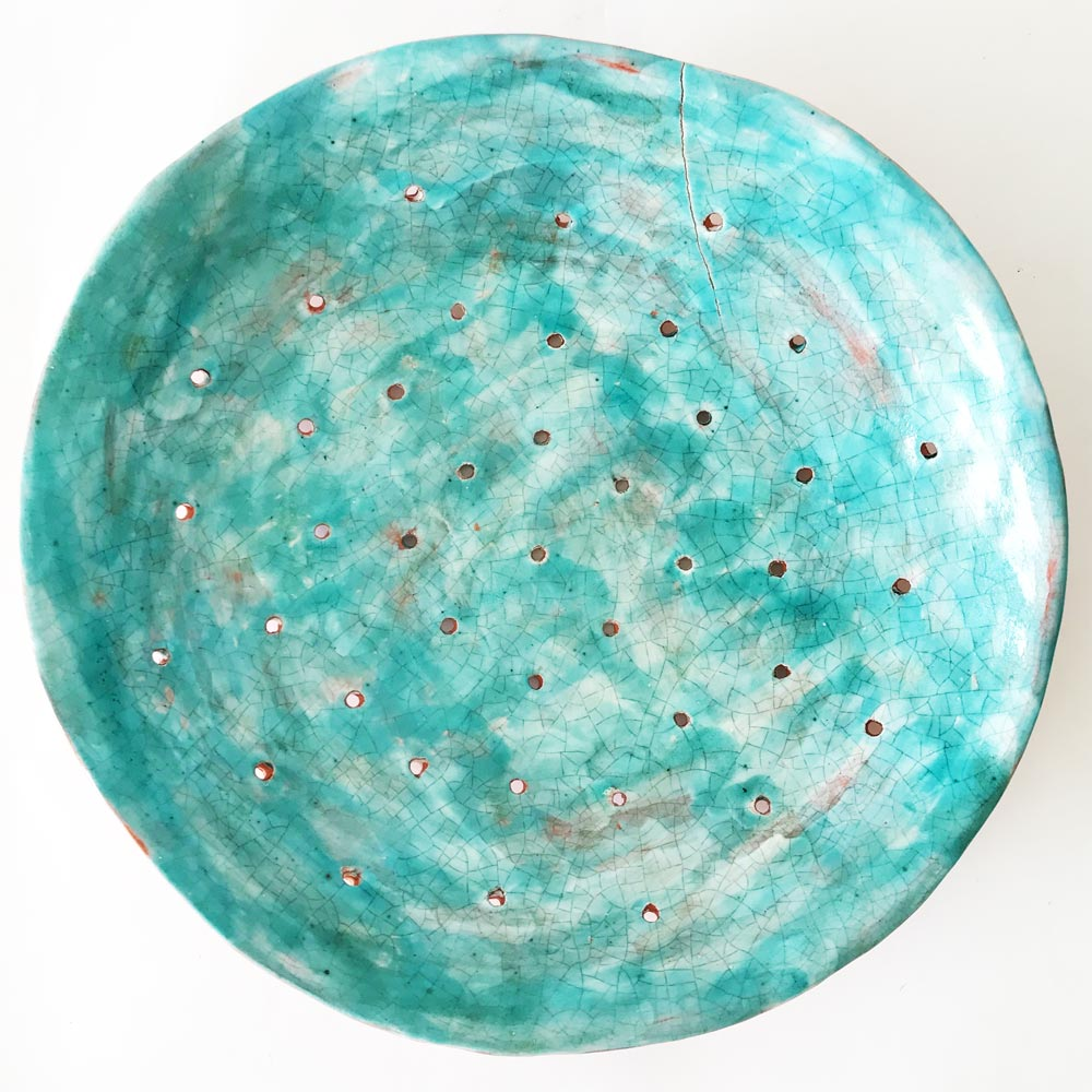Ceramic bowl with blue painting insid
